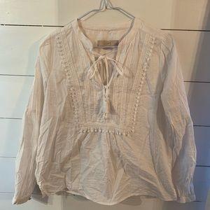 White bibbed blouse